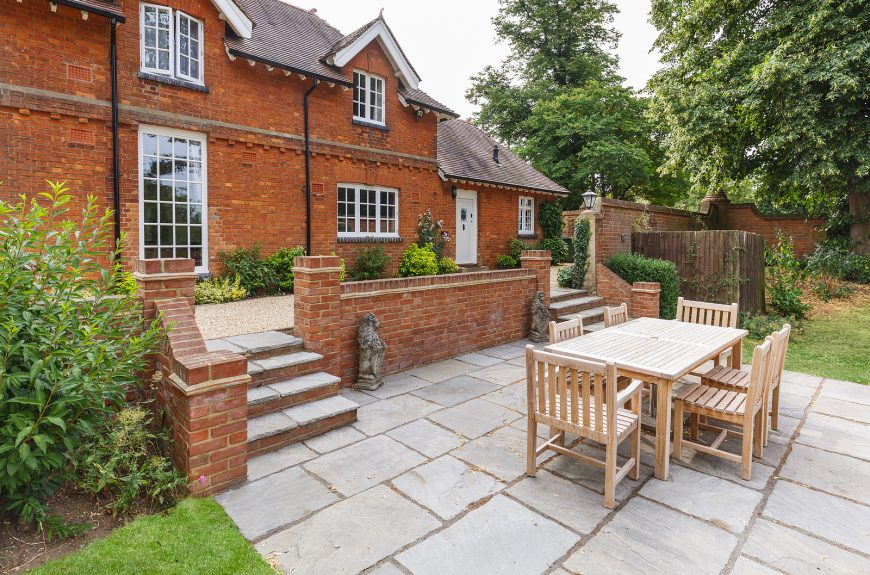 Large home with reclaimed teak furniture outside