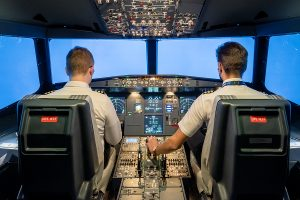 Two men taking helicopter pilot training courses