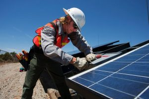 Worker providing commercial solar financing